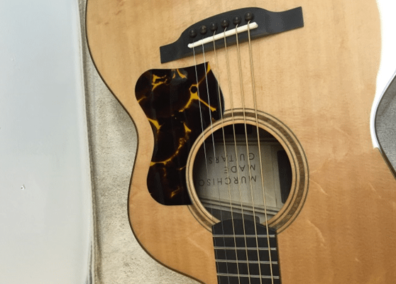 Murchison Made Guitars in New Prague, Minnesota uses RhinoCAM® to assist in the product of The Murchison, a 4th generation acoustic guitar design.
